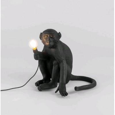 LAMPE SINGE EN RESINE POSITION ASSIE EXT 34X30X32CM